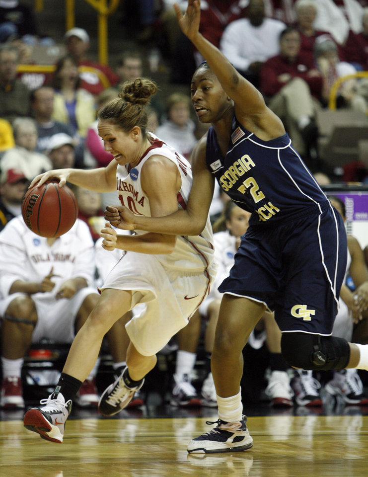 Carlee Roethlisberger dribbles by Chelsea Regins (32) in the second half as the University of Oklahoma (OU) plays Georgia Tech in round two of the 2009 NCAA Division I Women's Basketball Tournament at Carver-Hawkeye Arena at the University of Iowa in Iowa City, IA on Tuesday, March 24, 2009. 
