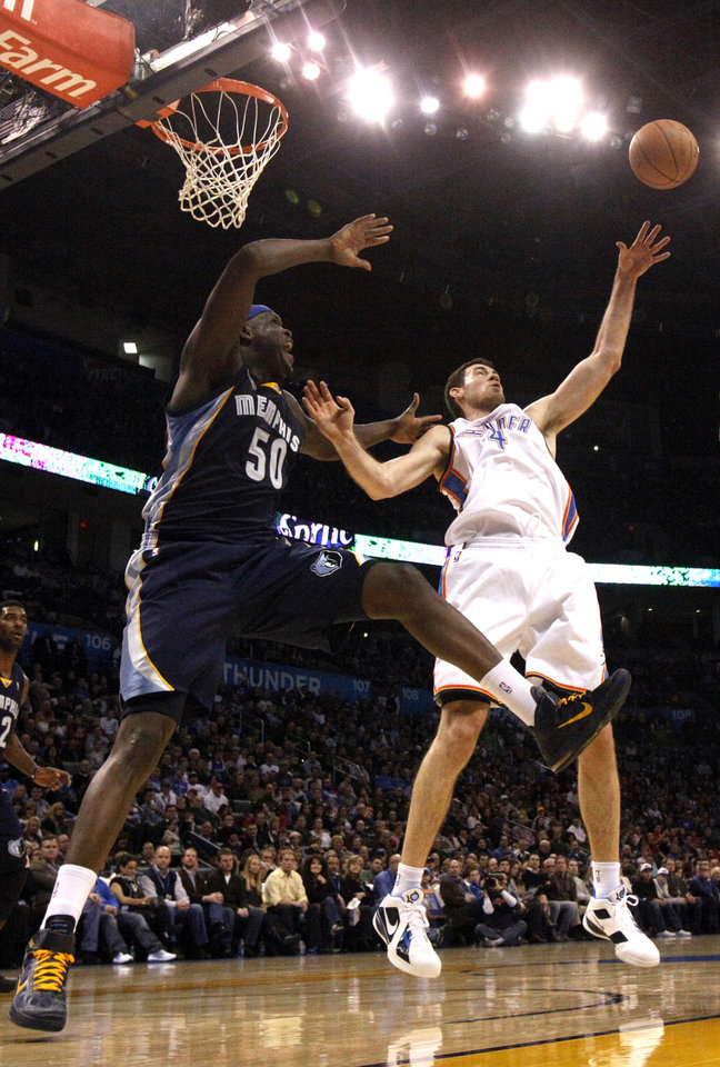 Oklahoma City's Nick Collison (4) fights Memphis' Zach Randolph for a rebound during the NBA basketball game between the Oklahoma City Thunder and the Memphis Grizzlies, Saturday, Jan. 8, 2011, at the Oklahoma City Arena. Photo by Sarah Phipps, The Oklahoman