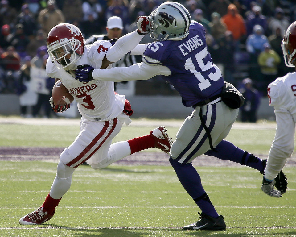 Oklahoma's Sterling Shepard (3) fights off Kansas State's Randall Evans (15) during an NCAA college football game between the Oklahoma Sooners and the Kansas State University Wildcats at Bill Snyder Family Stadium in Manhattan, Kan., Saturday, Nov. 23, 2013. Oklahoma won 41-31. Photo by Bryan Terry, The Oklahoman
