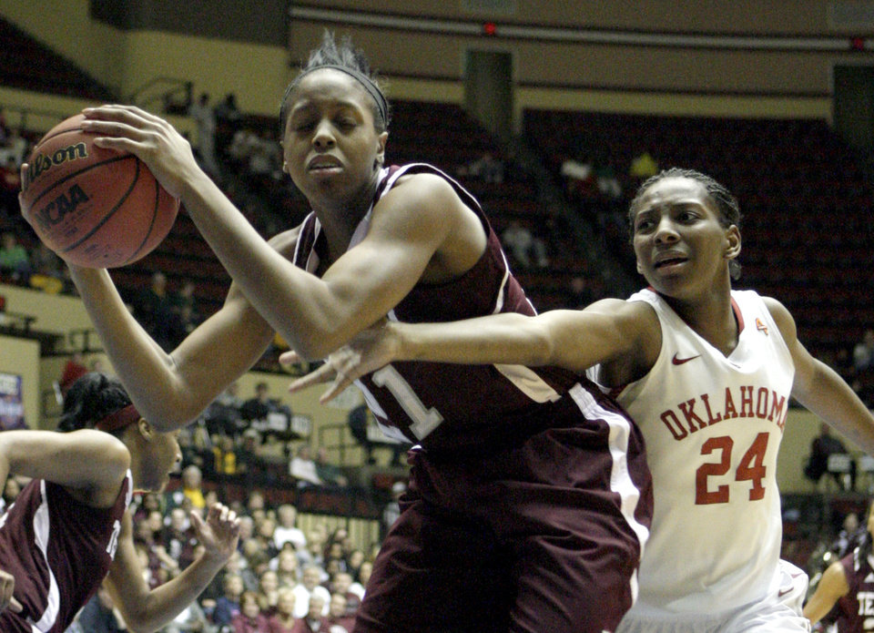 Oklahoma's Sharane Campbell (24) fights for a rebound from Texas A&M's Adaora Elonu (21) during the Big 12 tournament women's college basketball game between the University of Oklahoma Sooners and the Texas A&M Aggies at Municipal Auditorium in Kansas City, Mo., Friday, March 9, 2012. Photo by Sarah Phipps, The Oklahoman.