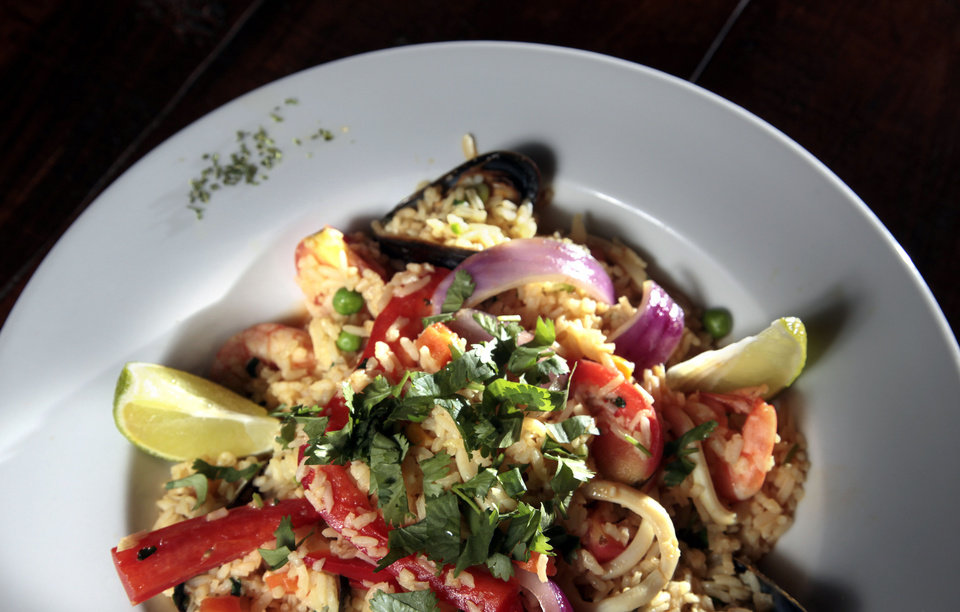 Arroz con Mariscos is Peruvian-style paella served at Ceviche House in Warr Acres. <strong>SARAH PHIPPS - THE OKLAHOMAN</strong>