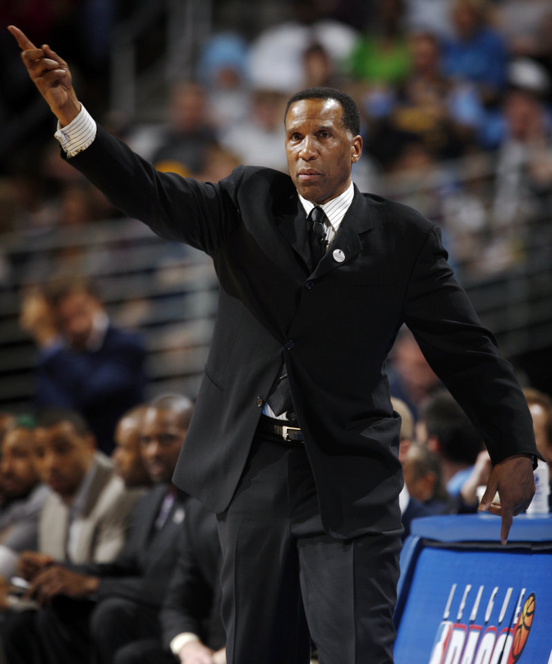Photo - Denver Nuggets acting head coach Adrian Dantley directs his team while facing the Los Angeles Lakers in the first quarter of an NBA basketball game in Denver on Thursday, April 8, 2010.  (AP Photo/David Zalubowski) ORG XMIT: CODZ115