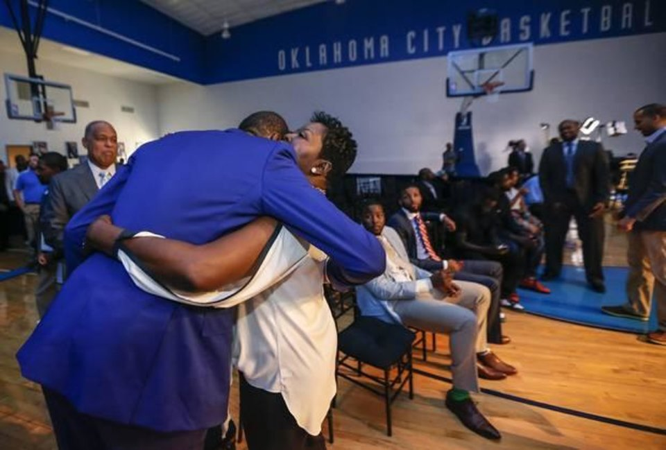 Photo -  Oklahoma City Thunder's Kevin Durant hugs his mother Wanda Pratt following a news conference announcing Durant as the winner of the 2013-14 Kia NBA Basketball Most Value Player Award in Oklahoma City, Okla. on Tuesday, May 6, 2014. Photos by Chris Landsberger, The Oklahoman