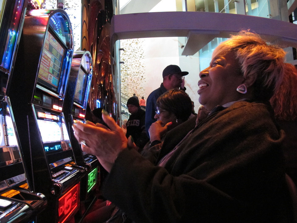 Photo - In this April 2, 2012, file photo, Lorraine Capers, from the Brooklyn borough of New York, claps after winning seven free spins on a slot machine at the new $2.4 billion Revel casino resort moments after it opened in Atlantic City, N.J. Revel announced on Aug. 12, 2014, that it will close on Sept. 10. (AP Photo/Wayne Parry, File)