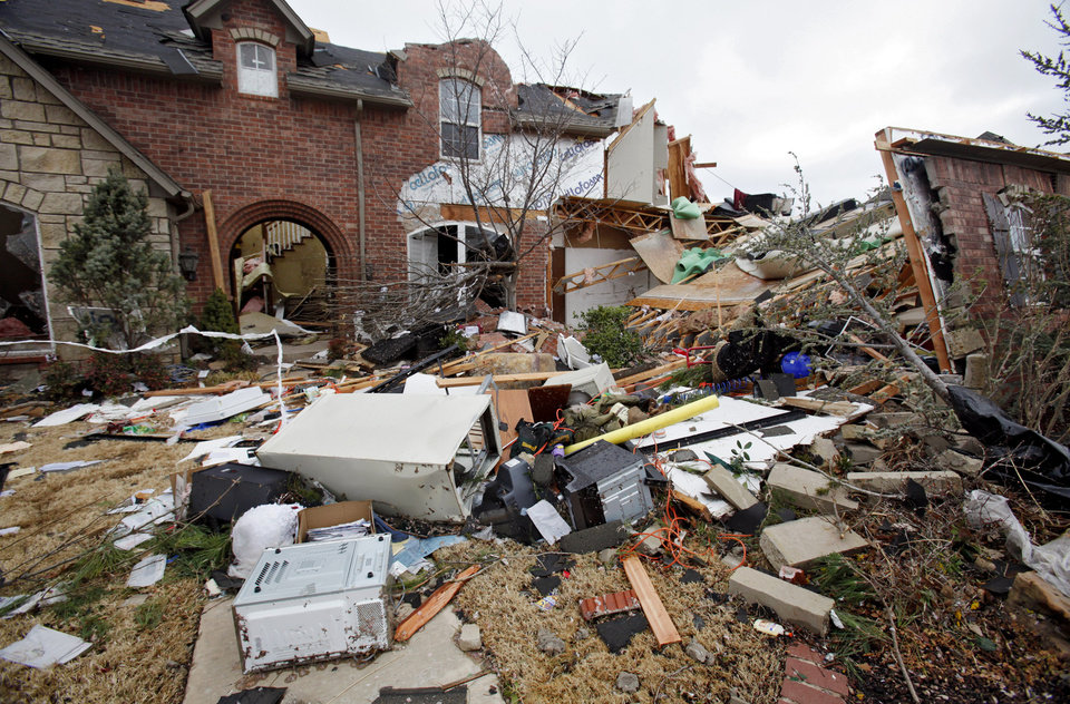 Photo - TORNADO / STORM / DAMAGE / HOUSE: Damage to a home in the Oak Tree housing addition on Wednesday, Feb. 11, 2009, after a tornado hit the area on Tuesday in Edmond, Okla. PHOTO BY CHRIS LANDSBERGER, THE OKLAHOMAN  ORG XMIT: KOD