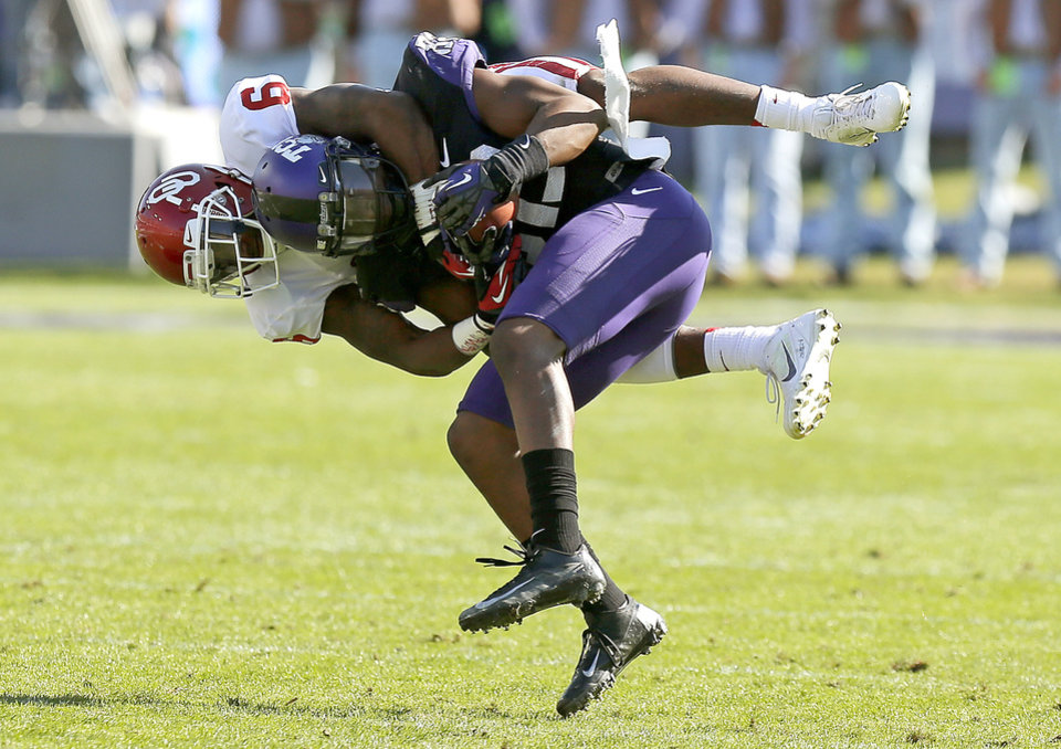 Oklahoma\'s Demontre Hurst (6) brings down TCU\'s Josh Boyce (82) during a college football game between the University of Oklahoma Sooners (OU) and the Texas Christian University Horned Frogs (TCU) at Amon G. Carter Stadium in Fort Worth, Texas, Saturday, Dec. 1, 2012. Oklahoma won 24-17. Photo by Bryan Terry, The Oklahoman
