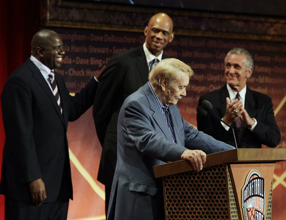 ORRECTS THAT BUSS WAS 80-YEARS-OLD, AND NOT 79 AS ORIGINALLY SENT -  FILE - In this Aug. 13, 2010 file photo, Basketball Hall of Fame inductee, Los Angeles Lakers owner Jerry Buss, foreground, speaks as, from background left to right, Magic Johnson, Kareem Abdul Jabbar and Pat Riley react during the enshrinement ceremony in Springfield, Mass. Buss, the Lakers' playboy owner who shepherded the NBA franchise to 10 championships, has died. He was 80. Bob Steiner, an assistant to Buss, confirmed Monday, Feb. 18, 2013  that Buss had died in Los Angeles. Further details were not available. (AP Photo/Elise Amendola, File)
