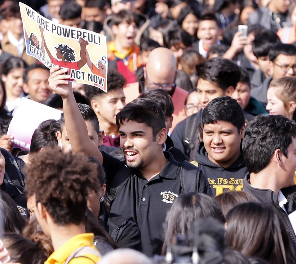 Photo -  Immigrant youth and students at Santa Fe South High School stage a walkout and rally Thursday. [Photo by Steve Sisney, The Oklahoman]