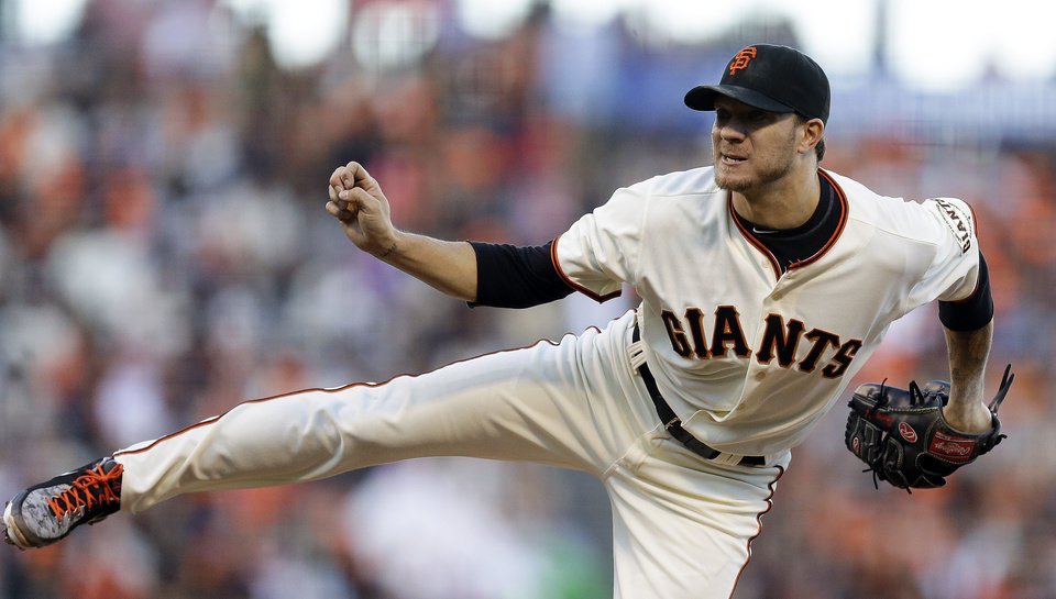 Photo - San Francisco Giants' Jake Peavy works against the Milwaukee Brewers in the second inning of a baseball game Saturday, Aug. 30, 2014, in San Francisco. (AP Photo/Ben Margot)