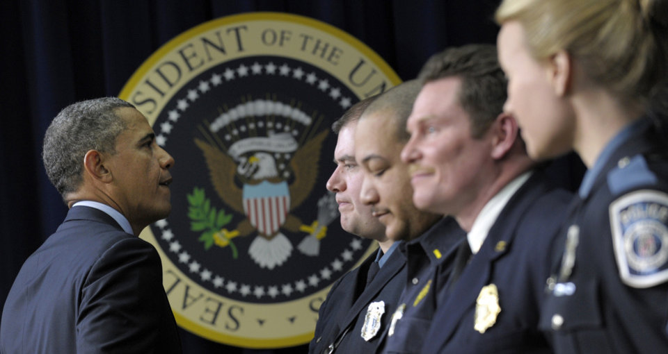 President Barack Obama greets first responders after speaking in the South Court Auditorium of the Eisenhower Executive Office building on the White House complex in Washington, Tuesday, Feb. 19, 2013, to urge Congress to come up with an alternative plan to avert automatic spending cuts set to kick in on March 1, 2013. (AP Photo/Susan Walsh)