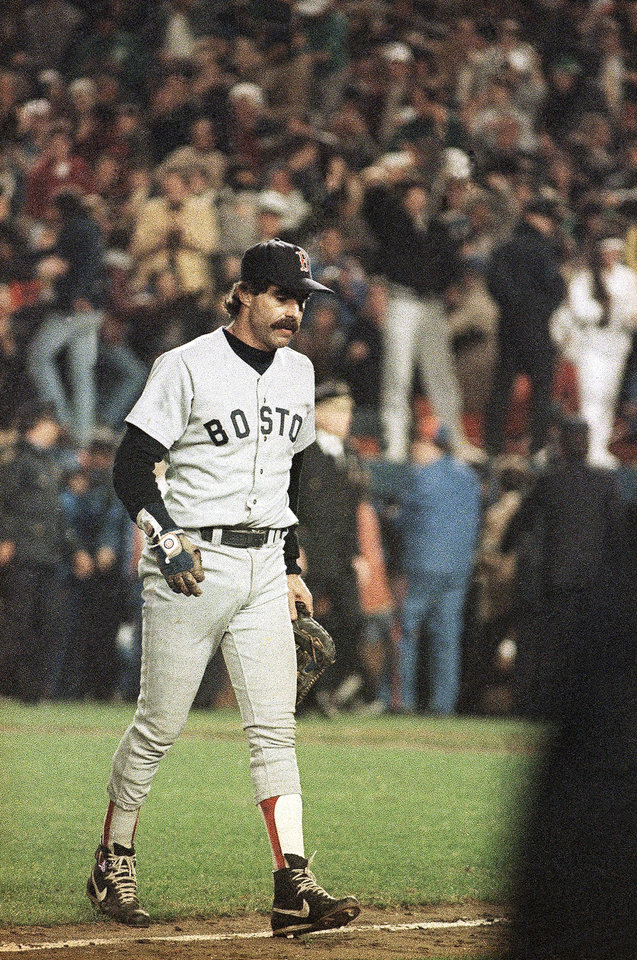 Photo -   FILE - In this Oct. 25, 1986 file photo, Boston Red Sox first baseman Bill Buckner is a picture of dejection as he leaves the field after committing an error on a ball hit by New York Mets' Mookie Wilson, which allowed the winning run to score in the sixth game of the World Series, in New York. The baseball made famous when it rolled through Buckner's legs is being sold. Heritage Auctions says the ball is expected to bring in more than $100,000 during Friday's, May 4, 2012 auction in Dallas. (AP Photo/Rusty Kennedy, File)