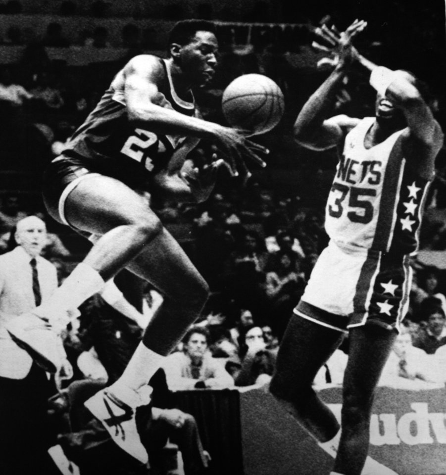 Photo - Former OU basketball player Wayman Tisdale. Indiana's Wayman Tisdale steals a pass meant for New York's Tony Brown (35). (AP LaserPhoto) Photo taken unknown, photo published 11/14/1986 in The Daily Oklahoman. ORG XMIT: KOD