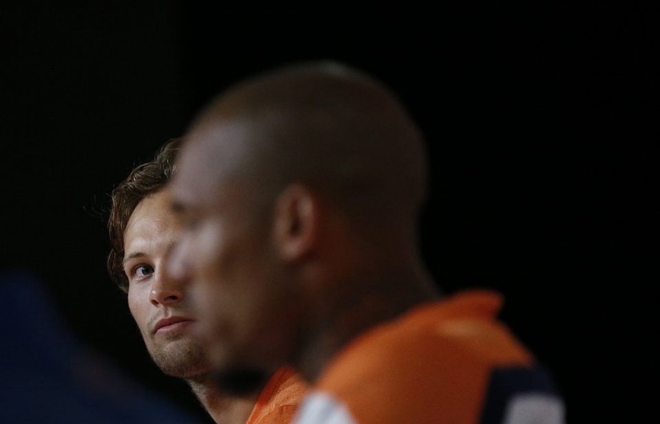 Photo - Daley Blind, left, watches his team mate Nigel de Jong, right, of the Netherlands during a press conference after a training session in Rio de Janeiro, Brazil, Sunday, June 15, 2014. His commanding play in that match has sparked intense speculation in England that he could be playing in the red of Manchester United next season when current Netherlands coach Louis van Gaal moves to Old Trafford and attempts to rebuild the storied club after a disastrous season. (AP Photo/Wong Maye-E)