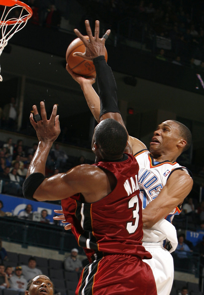Photo - Oklahoma City's Russell Westbrook (0) shoots as Miami's Dwyane Wade (3) defends during the NBA game between the Oklahoma City Thunder and the Miami Heat Sunday Jan. 18, 2009, at the Ford Center in Oklahoma City. PHOTO BY SARAH PHIPPS, THE OKLAHOMAN