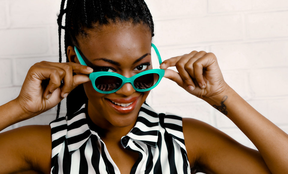 Kate Spade turquoise modified cat-eye sunglasses and Gianni Bini striped blouse from Dillard's, Penn Square Mall.  Model is Albreuna. Makeup by Lilly Stone, Sooo Lilly Cosmetics. Photo by Chris Landsberger, The Oklahoman. <strong>CHRIS LANDSBERGER</strong>