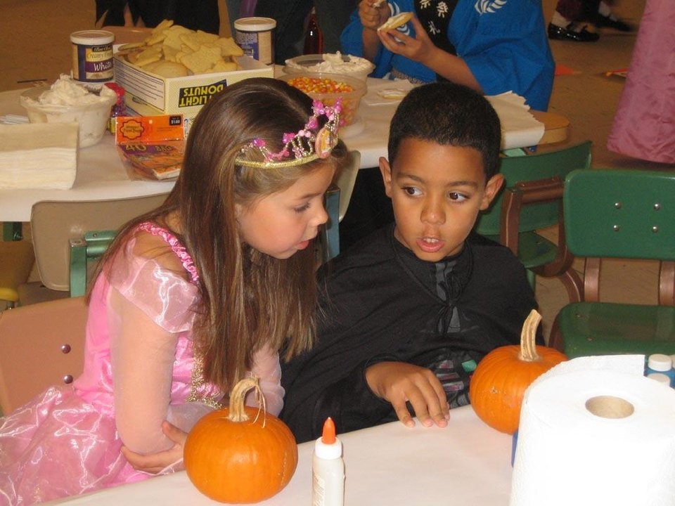 Mikayla Johnston and Che Stiggers decorate pumpkins at the Family Fall Festival at First Christian Church in Guthrie last Sunday.<br/><b>Community Photo By:</b> Sharon Johnston<br/><b>Submitted By:</b> Karen,