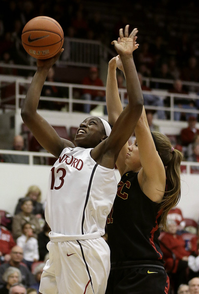 Photo - Stanford forward Chiney Ogwumike (13) shoots against USC forward Cassie Harberts during the first half of an NCAA college basketball game in Stanford, Calif., Monday, Jan. 27, 2014. (AP Photo/Jeff Chiu)