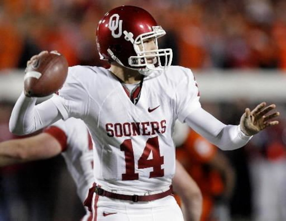 Oklahoma's  Sam  Bradford (14) has his left thumb taped up as he looks to throw the ball during the first half of Bedlam at Boone Pickens Stadium on Saturday, Nov. 29, 2008, in Stillwater, Okla. STAFF PHOTO BY CHRIS LANDSBERGER