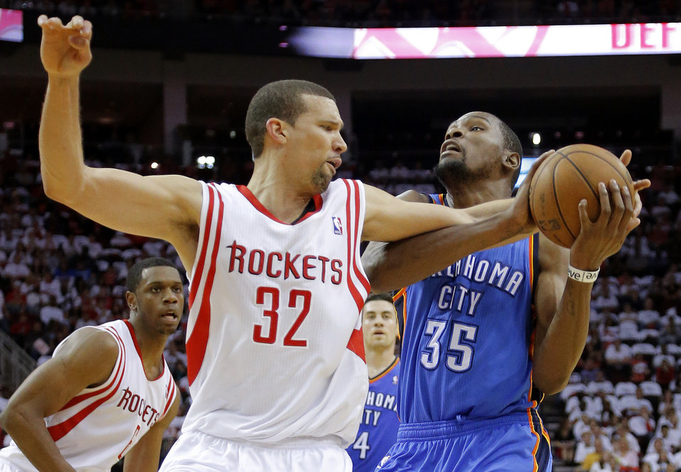 Oklahoma City\'s Kevin Durant (35) tries to get past Houston\'s Francisco Garcia (32) during Game 3 in the first round of the NBA playoffs between the Oklahoma City Thunder and the Houston Rockets at the Toyota Center in Houston, Texas, Saturday, April 27, 2013. Photo by Bryan Terry, The Oklahoman