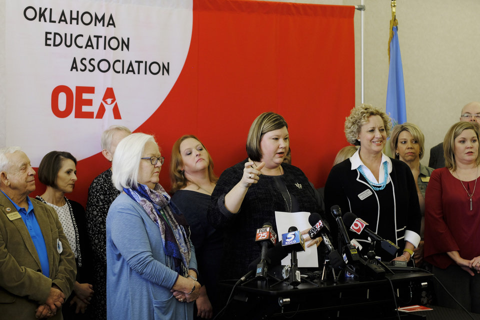Photo -  Alicia Priest, President of the Oklahoma Education Association, with her own middle school teacher Vicki Vaughan by her side, speaks during a news conference at the Oklahoma Education Association. [Photo by Doug Hoke, The Oklahoman]