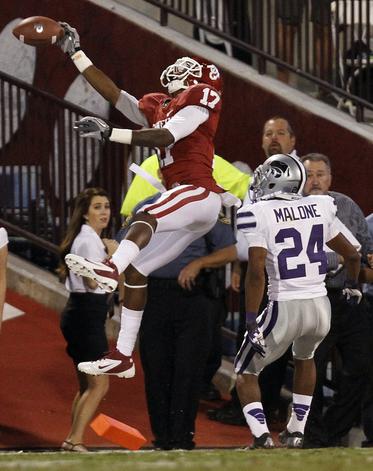 Photo - Oklahoma's Trey Metoyer (17) misses a catch in front of Kansas State's Nigel Malone (24) during the college football game between the University of Oklahoma Sooners (OU) and the Kansas State University Wildcats (KSU) at the Gaylord Family-Memorial Stadium on Saturday, Sept. 22, 2012, in Norman, Okla. Photo by Chris Landsberger, The Oklahoman