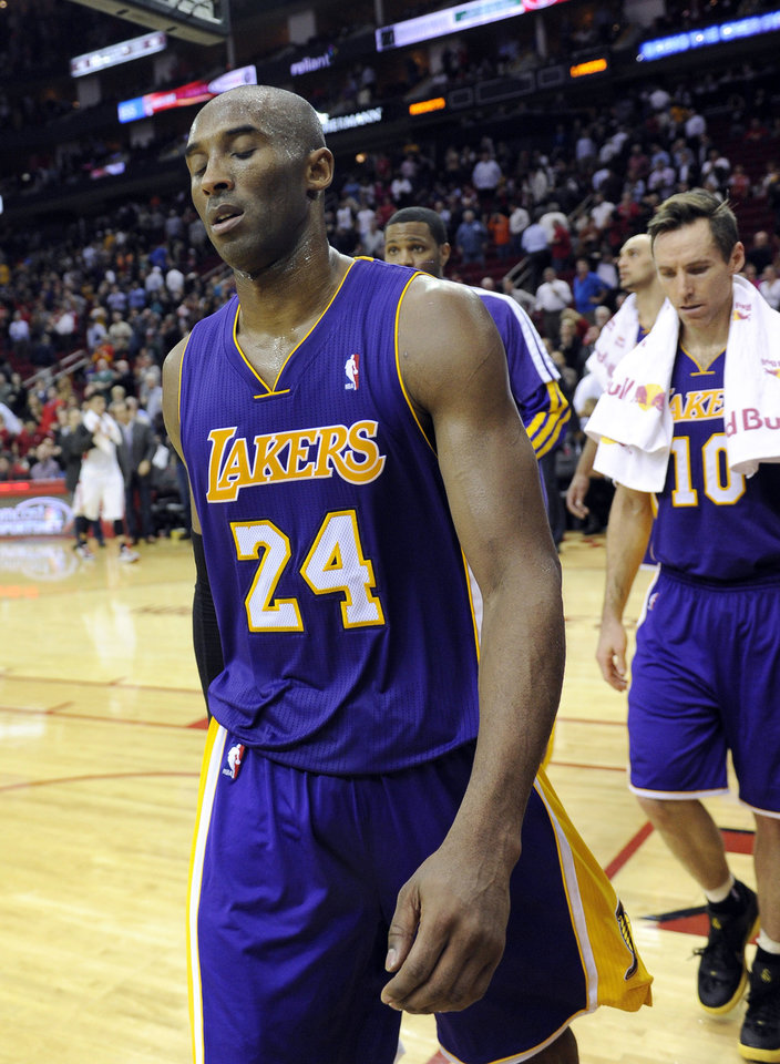 Los Angeles Lakers Kobe Bryant (24) and Steve Nash (10) leave the floor after losing to the Houston Rockets 125-112 in an NBA basketball game Tuesday, Jan. 8, 2013, in Houston. (AP Photo/Pat Sullivan)