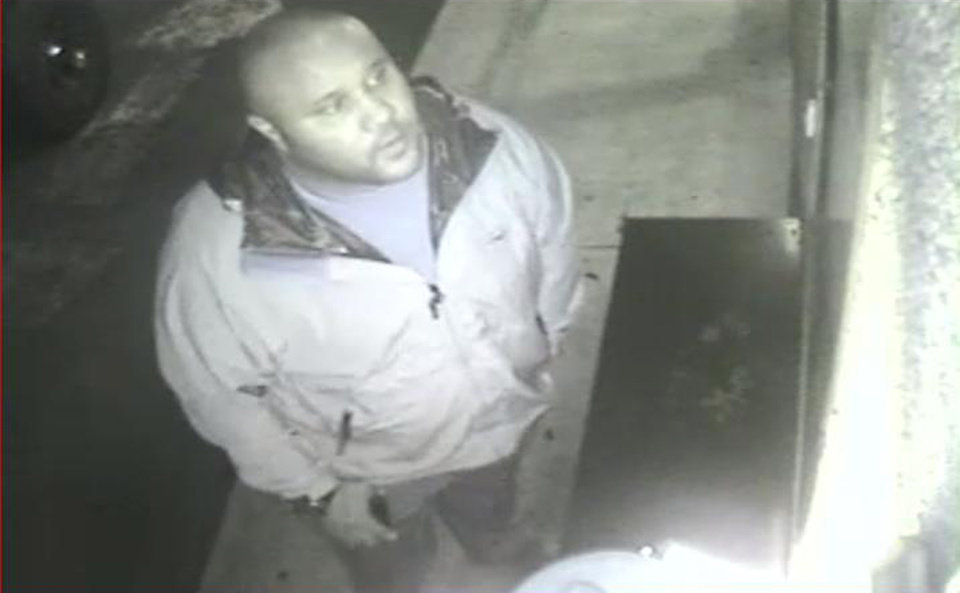 Photo - ADDS DATE VIDEO WAS TAKEN - This image provided by the Irvine Police Department shows Christopher Dorner from Jan. 28, 2013 surveillance video at an Orange County, Calif., hotel. More than 100 officers, including SWAT teams, were driven in glass-enclosed snow machines and armored personnel carriers in Big Bear Lake to hunt for this former Los Angeles police officer suspected of going on a deadly rampage to get back at those he blamed for ending his police career. (AP Photo/Irvine Police Department)