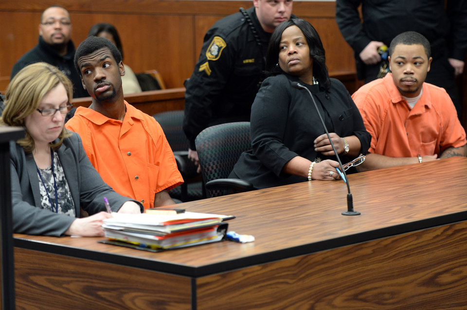 Photo - From left, Ed Thomas and Kristopher Pratt, both of Detroit, suspected in the death of Eastern Michigan student and football player Demarius Reed, look on during a preliminary exam in the 14A-1 district court in Pittsfield Township, Mich., on Wednesday, January 29, 2014. The exam was postponed until February, 3 at 2:30 p.m. (AP Photo/The Ann Arbor News, Melanie Maxwell)