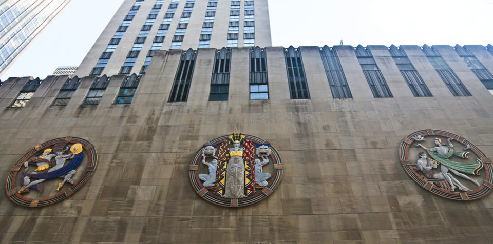 """In this March 24, 2014 photo, three colossal metal-and-enamel roundels created by art deco muralist Hildreth Meiere  stand out on the facade of Radio City Music Hall  in New York.  """"The Art Deco Murals of Hildreth Meiere,"""" a new book on the trail-blazing muralist who completed over 100 commissions in 16 states before her death in 1961, is set for May 1. (AP Photo/Bebeto Matthews)"""