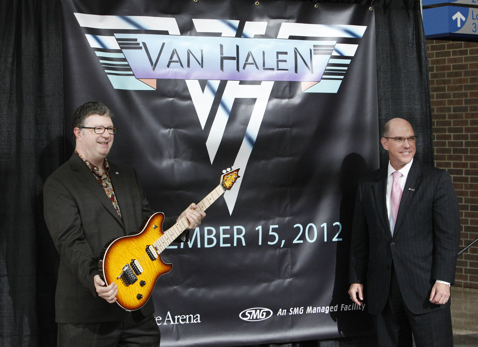 Photo - ACM@UCO CEO Scott Booker holds one of Eddie Van Halen's signature EVH guitars donated to the University of Central Oklahoma's Academy of Contemporary Music for auction as Gary Desjardins, general manager Chesapeake Energy Arena, looks on at Monday's concert announcement. Photos by Paul B. Southerland, The Oklahoman