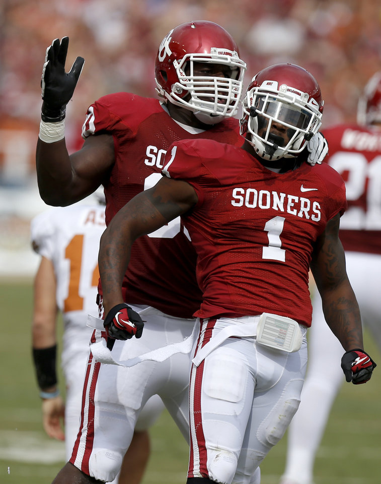 Photo - OU's Tony Jefferson (1) and David King (90) celebrate during the Red River Rivalry college football game between the University of Oklahoma (OU) and the University of Texas (UT) at the Cotton Bowl in Dallas, Saturday, Oct. 13, 2012. Oklahoma won 63-21. Photo by Bryan Terry, The Oklahoman