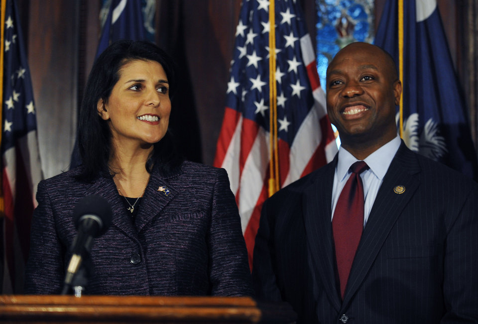 South Carolina Gov. Nikki Haley, left, announces U.S. Rep. Tim Scott, right, as Sen. Jim DeMint's replacement in the U.S. Senate during a news conference at the South Carolina Statehouse, Monday, Dec. 17, 2012, in Columbia, S.C., making him the only black Republican in Congress and the South's first black Republican senator since Reconstruction. (AP Photo/Rainier Ehrhardt)