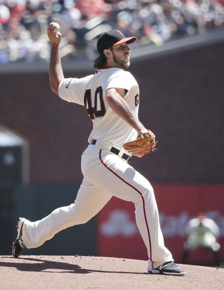 Photo - San Francisco Giants starting pitcher Madison Bumgarner throws to the Milwaukee Brewers during the first inning of a baseball game on Sunday, Aug. 31, 2014, in San Francisco. (AP Photo/Marcio Jose Sanchez)