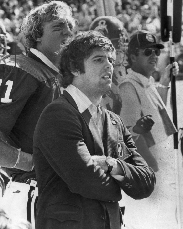 Photo - Former OU quarterback Steve Davis watches second-half action vs. Wake Forest in 1974. The Sooners jumped out to such a big lead, and eventually won 63-0, that Davis watched the second half in street clothes while resting a bruised knee. PHOTO BY BOB ALBRIGHT, The Oklahoman Archives
