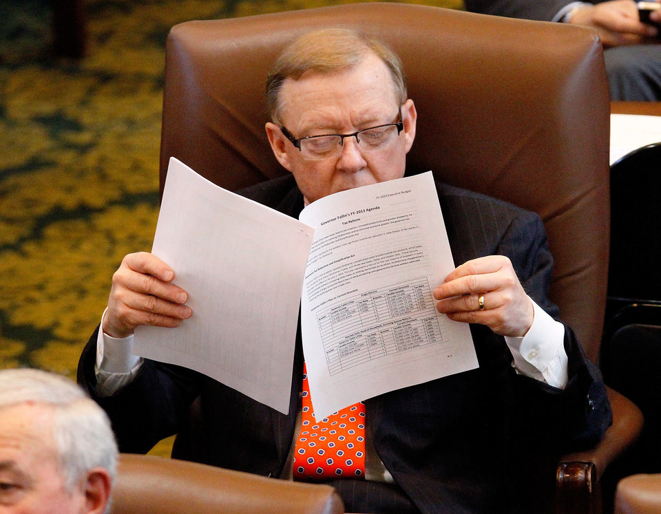 Photo - Rep. Earl Sears, Tulsa,  studies a paper outlining the governor's income tax reform proposal as Gov. Mary Fallin delivers her 2012 State of the State address to a joint session of the Oklahoma legislature in the House Chamber on the opening day of the session, Monday, Feb, 6, 2012.   Photo by Jim Beckel, The Oklahoman