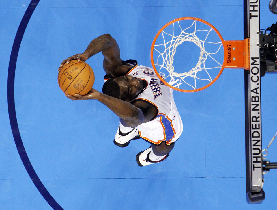 Oklahoma City\'s Kendrick Perkins (5) dunks the ball during the NBA basketball game between the Miami Heat and the Oklahoma City Thunder at Chesapeake Energy Arena in Oklahoma City, Sunday, March 25, 2012. Oklahoma City won, 103-87. Photo by Nate Billings, The Oklahoman
