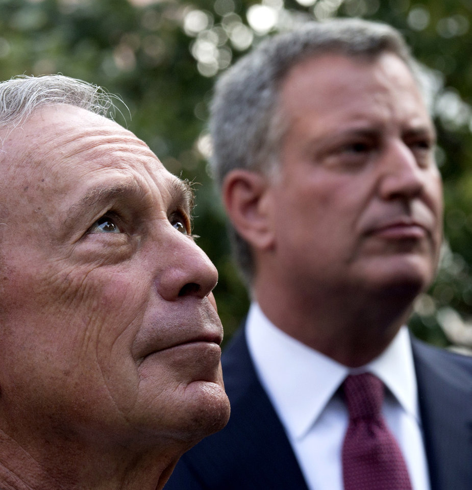 Photo - New York Mayor Michael Bloomberg, left, and Democratic mayoral hopeful Bill de Blasio attend a 9/11 Memorial ceremony Wednesday, Sept. 11, 2013, marking the 12th anniversary of the 2001 terrorist attacks on the World Trade Center in New York. (AP Photo/Adrees Latif, Pool)