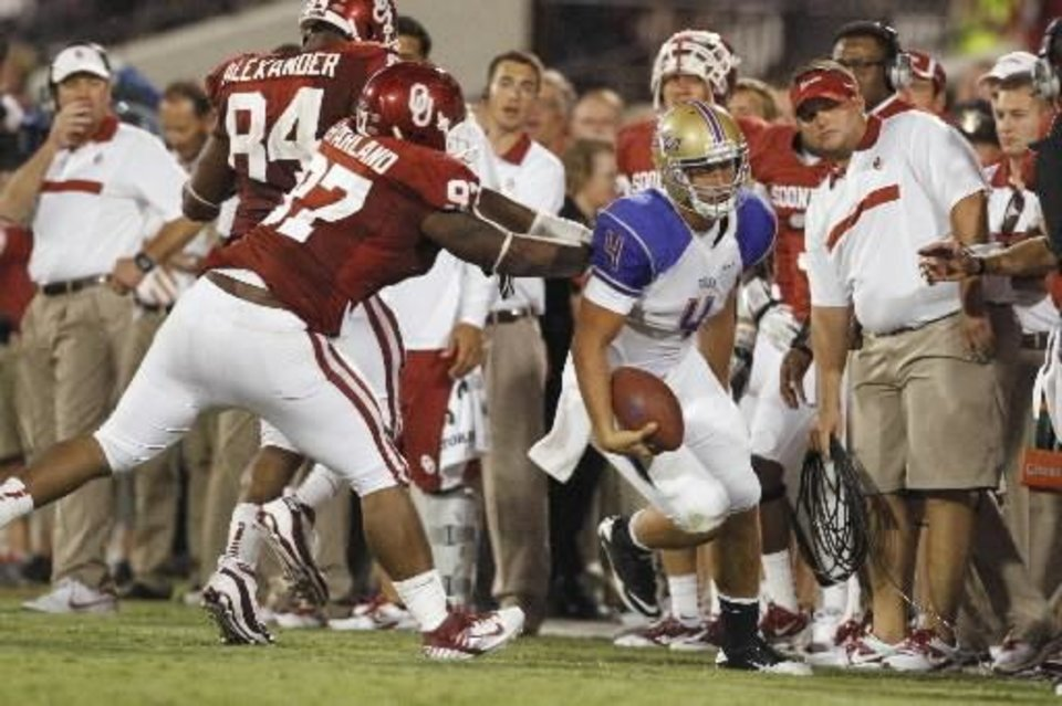 Oklahoma's Jamarkus McFarland (97) pushes Tulas quarterback G.J. Kinne our of bounds during the second half of the college football game between the University of Oklahoma Sooners ( OU) and the Tulsa University Hurricanes (TU) at the Gaylord Family-Memorial Stadium on Saturday, Sept. 3, 2011, in Norman, Okla. Photo by Steve Sisney, The Oklahoman ORG XMIT: KOD