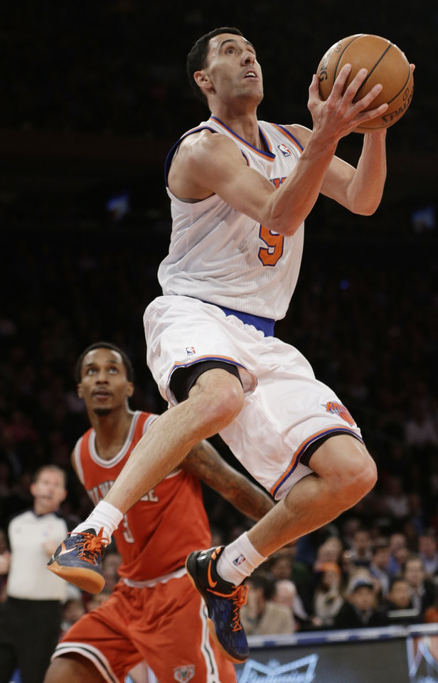 Photo - New York Knicks' Pablo Prigioni (9), of Argentina, drives past Milwaukee Bucks' Brandon Jennings (3) during the first half of an NBA basketball game on Friday, April 5, 2013, in New York. (AP Photo/Frank Franklin II)