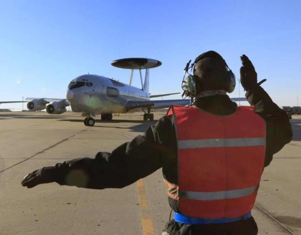 Photo -  An E-3 AWACS operated by the U.S. Air Force prepares to depart Tinker Air Force Base in this 2015 file photo. Boeing won a major contract to upgrade NATO's AWACS fleet, which will help sustain more than 100 jobs in Oklahoma City. While engineering and management of the project is based in Oklahoma City, the aircraft will remain in Europe. [OKLAHOMAN ARCHIVES]