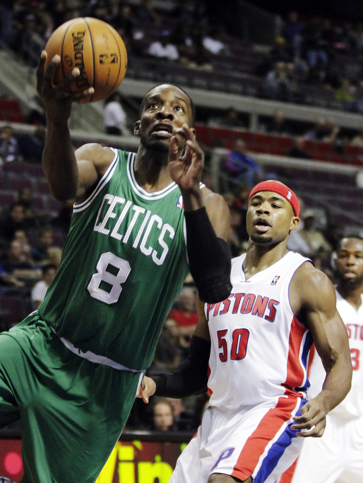 Boston Celtics forward Jeff Green (8) drives to the basket past Detroit Pistons forward Corey Maggette (50) in the first half of an NBA basketball game, Sunday, Nov. 18, 2012, in Auburn Hills, Mich. (AP Photo/Duane Burleson)