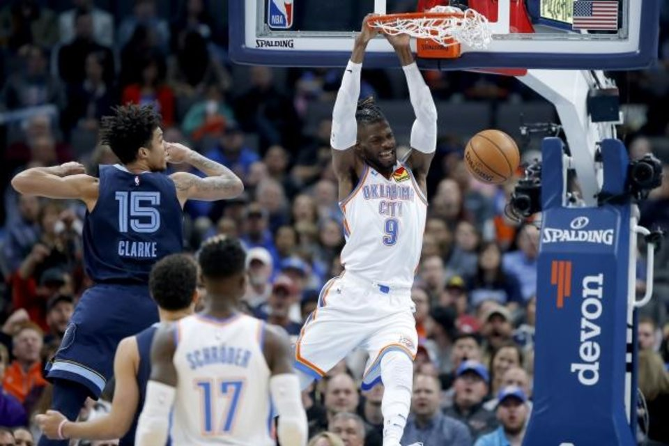 Photo -  Nerlens Noel (9) slams in a dunk during the Thunder's 126-122 win against the Grizzlies on Dec. 18. [Bryan Terry/The Oklahoman]