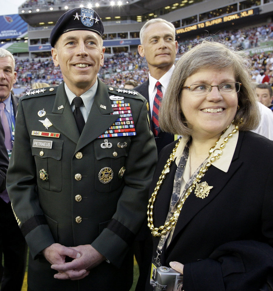 Photo -   FILE - In this Feb. 1, 2009 file photo, Gen. David Petraeus, commander U.S. Central Command, left, stands with his wife Holly before the NFL Super Bowl XLIII football game between the Arizona Cardinals and the Pittsburgh Steelers in Tampa, Fla. Gen. Petraeus, the retired four-star general who led the U.S. military campaigns in Iraq and Afghanistan, resigned Friday, Nov. 9, 2012 as director of the CIA after admitting he had an extramarital affair. (AP Photo/David J. Phillip, File)