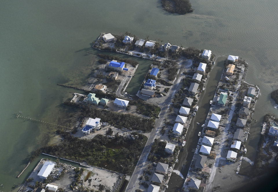 Photo - Damaged houses are shown in the aftermath of Hurricane Irma, Monday, Sept. 11, 2017, in the Florida Keys. (Matt McClain/The Washington Post via AP, Pool)