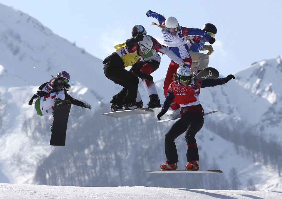 Photo - Czech Republic's Eva Samkova, front right, leads the field in the women's snowboard cross final at the Rosa Khutor Extreme Park, at the 2014 Winter Olympics, Sunday, Feb. 16, 2014, in Krasnaya Polyana, Russia. Samkova went on to win the gold medal. (AP Photo/Luca Bruno)