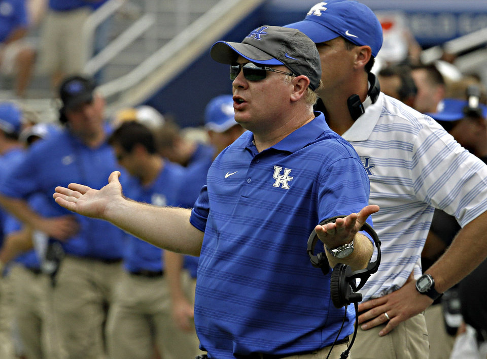 Photo - Kentucky coach Mark Stoops gestures as he questions his defense after allowing Tennessee-Martin to score in the fourth quarter in their NCAA college football game in Lexington, Ky., Saturday, Aug. 30, 2014. Kentucky beat Tennessee-Martin 59-14. (AP Photo/Garry Jones)