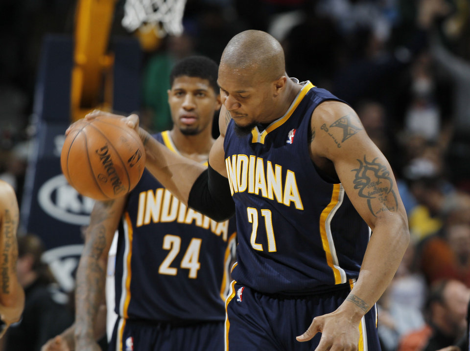 Photo - Indiana Pacers forward David West, front, slams the ball on the court as forward Paul George looks on after the Denver Nuggets' 102-101 victory over the Pacers in an NBA basketball game in Denver on Monday, Jan. 28, 2013. George fouled Nuggets guard Andre Iguodala with four-tenths of a second remaining in the game to send Iguodala to the free throw line for the winning score. (AP Photo/David Zalubowski)