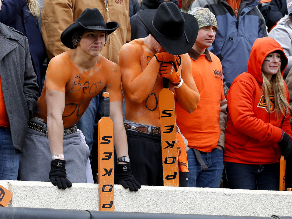 Oklahoma State fans react during the final minute of the Bedlam college football game between the Oklahoma State University Cowboys (OSU) and the University of Oklahoma Sooners (OU) at Boone Pickens Stadium in Stillwater, Okla., Saturday, Dec. 7, 2013. Oklahoma won 33-24. Photo by Bryan Terry, The Oklahoman