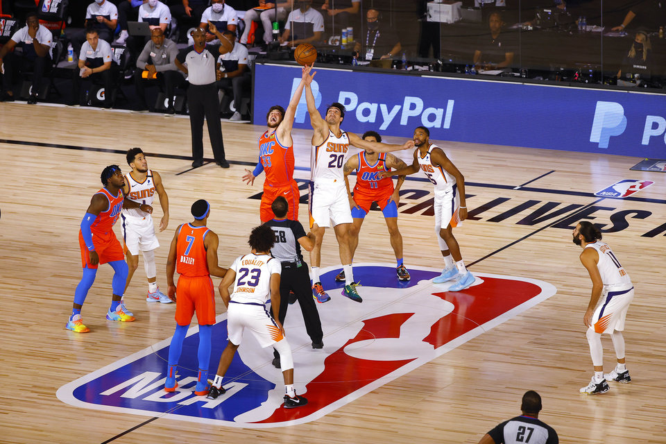 Photo - Aug 10, 2020; Lake Buena Vista, Florida, USA;  Mike Muscala #33 of the Oklahoma City Thunder and Dario Saric #20 of the Phoenix Suns go up for the tip off during a NBA basketball game at The Field House. Mandatory Credit: Mike Ehrmann/Pool Photo-USA TODAY Sports