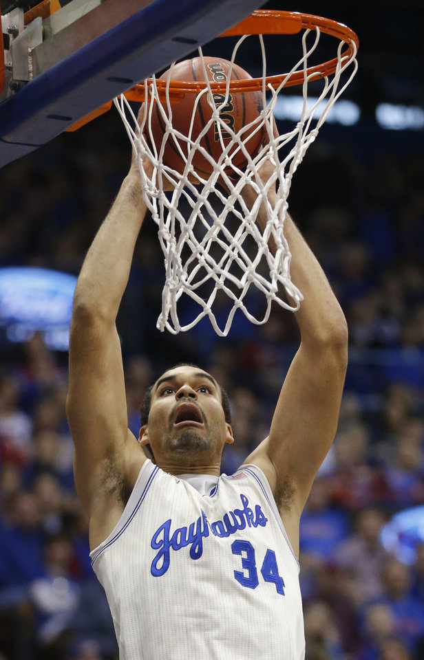 Photo - Kansas forward Perry Ellis dunks during the first half of an NCAA college basketball game against TCU in Lawrence, Kan., Saturday, Feb. 15, 2014. (AP Photo/Orlin Wagner)